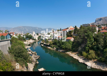The village of Mostar and its famous Stari Most 'Old Bridge' over the Neretva River in Bosnia-Herzegovina. - Stock Photo
