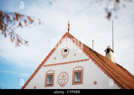 Holasovice - facade of decorated house, UNESCO world heritage site, South Bohemia, Czech Republic - Stock Photo