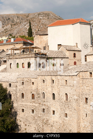 Buildings of the old town in Mostar in Bosnia and Herzegovina. - Stock Photo