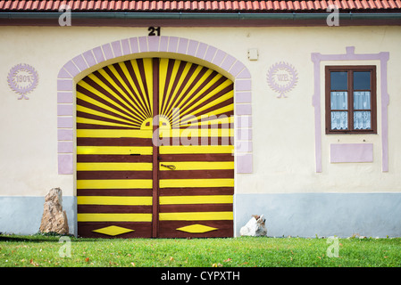 colorful gate to house in Holesovice, UNESCO world heritage site, South Bohemia, Czech Republic - Stock Photo