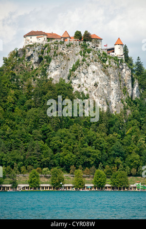 Bled castle on a rocky promontory overlooking Lake Bled in the Julian Alps in northwest Slovenia. - Stock Photo