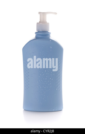 Blue shampoo bottle with water drops. Isolated on white background - Stock Photo