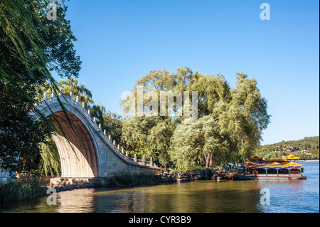 Traditional Chinese arch bridge in Summer Palace - Stock Photo