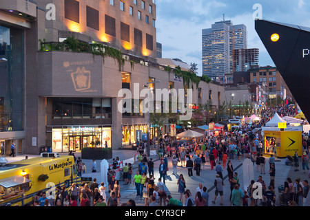Ste-Catherine street in the evening during the Just for Laughs festival, Montreal, province of Quebec, Canada. - Stock Photo