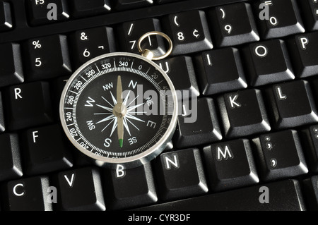 computer keyboard and compass showing internet navigation concept - Stock Photo