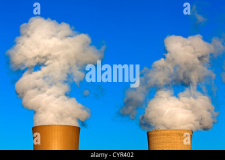 Smoking cooling tower of a nuclear power reactor, Germany - Stock Photo