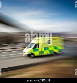 ambulance emergency response speeding along the motorway - Stock Photo