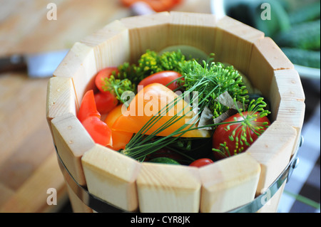 preserved tomatoes, cucumbers, peppers in wooden jar - Stock Photo