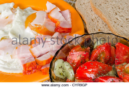 Fried eggs breakfast with salad and bacon - Stock Photo
