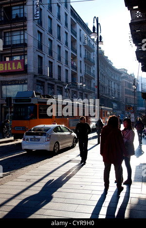 People walking and shopping in via Torino, famous central street in Milan, Milano, Italy, Italia - Stock Photo