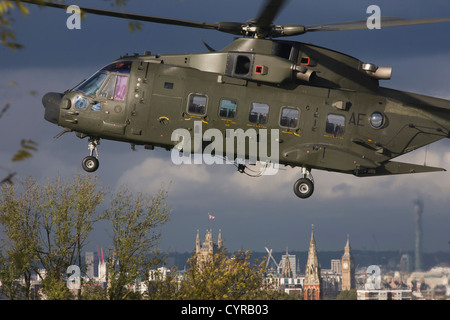 An AgustaWestland AW101 makes a controlled landing in a south London public park. - Stock Photo