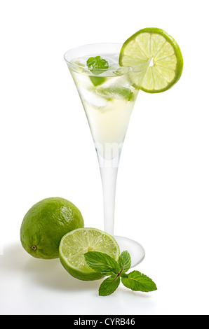 Drink with lime and mint in a champagne glass - Stock Photo