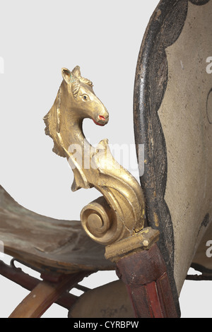 A German horse-drawn sleigh, mid 19th century Light wooden sleigh with iron fittings. The high curved runners are - Stock Photo