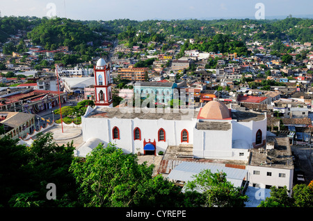 Mexico, Veracruz, Papantla, Views over Cathedral Zocalo and surrounding buildings set amongst trees. - Stock Photo