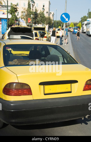 Taxi at the roadside, Athens, Greece - Stock Photo