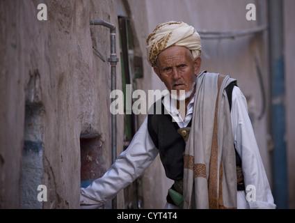 Old Yemeni Man Wearing Traditional Clothes And A Jambiya In A Street Of Sanaa, Yemen - Stock Photo