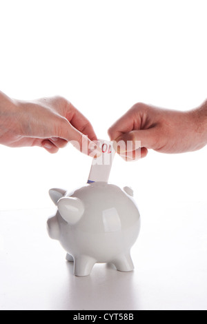 Piggy bank, couple,  hands and euro currency on white - Stock Photo