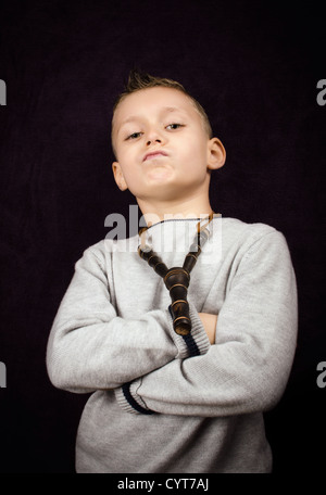 Studio shoot of a little boy with a bad attitude - Stock Photo