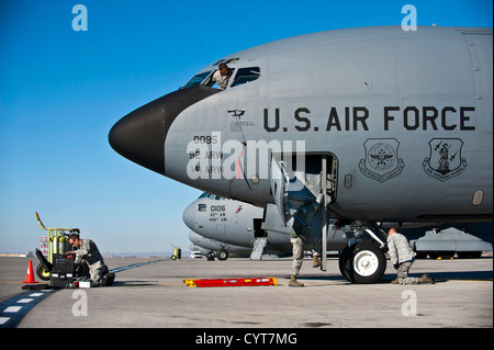 Crew chiefs from the 376th Expeditionary Aircraft Maintenance Squadron conduct maintenance on a KC-135 Stratotanker - Stock Photo