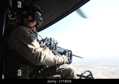 U.S. Marine Corps Cpl. Jeffery L. Allen, crew chief with Marine Light Attack Helicopter Squadron (HMLA) 469, Marine Aircraft Group 39, 3rd Marine Aircraft Wing (Forward), provides close air support over Helmand province, Afghanistan, Nov. 8, 2012. Allen p Stock Photo