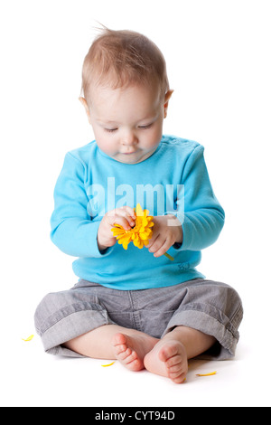 Small baby holding yellow flower. Isolated on white - Stock Photo