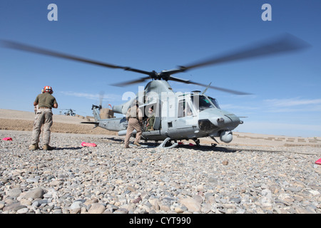 U.S. Marines with Marine Light Attack Helicopter Squadron (HMLA) 469 and HMLA-169, Marine Aircraft Group 39, 3rd Marine Aircraft Wing (Forward), land at Forward Operating Base (FOB) Shukvani, Helmand province, Afghanistan, Nov. 8, 2012. The squadrons refu Stock Photo