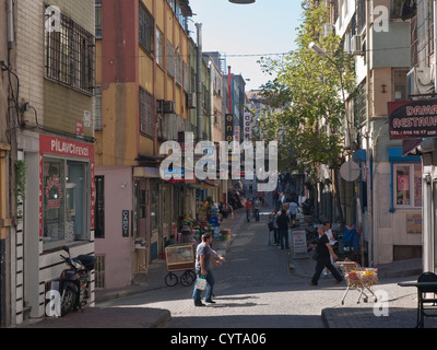 Street scene near Sultan Ahmed mosque in Istanbul Turkey, an area with many traditional houses and narrow streets - Stock Photo
