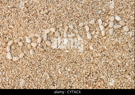 Croatia word made of pebbles, authentic picture of Hvar's beach - Stock Photo