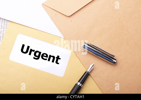urgent delivery concept with envelope letter or mail and word - Stock Photo