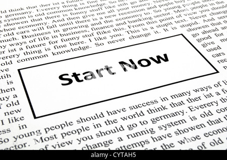 start now concept with newspaper showing business success concept - Stock Photo