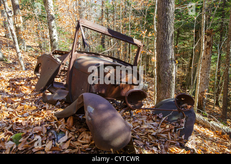 Rusted car in the Eastman Brook drainage of Thornton, New Hampshire USA - Stock Photo