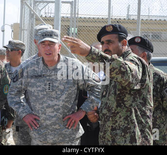 US General David H. Petraeus, commander of NATO and International Security Assistance Force speaks with Afghan Brig. - Stock Photo