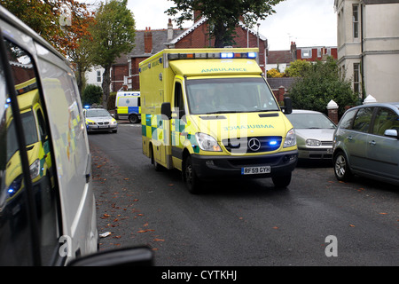 An Ambulance speeding through the streets of Brighton, East Sussex, UK. - Stock Photo