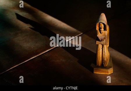 Wooden Statue of St. Francis in Afternoon Light with Shadow - Stock Photo