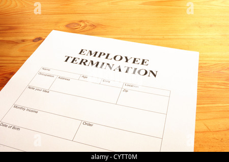 Employee Termination Form On Desk In Business Office Showing Job