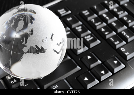 globe and keyboard showing global communication or internet concept - Stock Photo