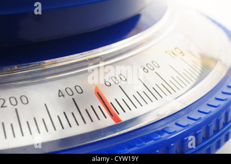 blue kitchen scales or balance showing cooking concept - Stock Photo