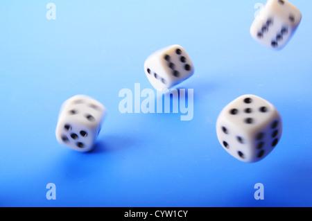 falling dice showing random fortune or casino concept - Stock Photo