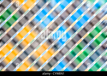 Abstract fuzzy background with grey, blue, green and orange colours. Geometric shapes: bright square lights and - Stock Photo