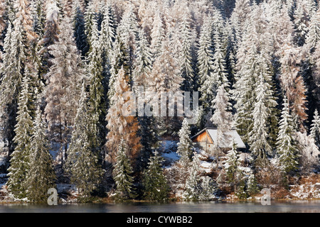A wooden building on Strbske Pleso Lake in the Tatras Mountains, Slovakia on a winters day - Stock Photo