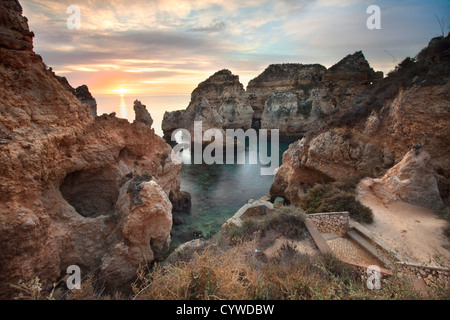 Ponta da Piedade sea stacks and arches captured at sunrise, Portugal. - Stock Photo