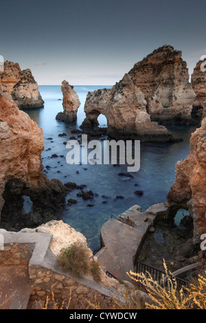 Ponta da Piedade sea stacks and arches captured at dusk, Portugal. - Stock Photo