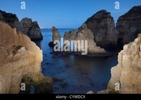 Ponta da Piedade sea stacks and arches captured at dusk, Portugal. - Stock Photo