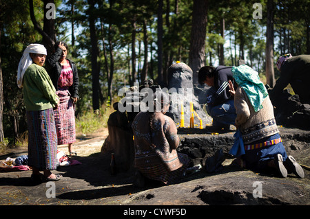 Local shaman perform a traditional K'iche' Maya ceremony using censers with smouldering incense and copal resin - Stock Photo