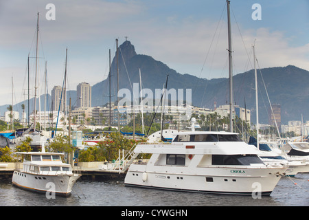 Boats in Guanabara Bay with Christ the Redeemer statue in background, Urca, Rio de Janeiro, Brazil - Stock Photo