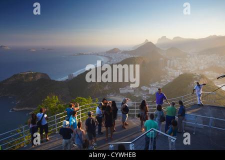 Tourists enjoying view of Rio from Sugar Loaf Mountain (Pao de Acucar), Urca, Rio de Janeiro, Brazil - Stock Photo