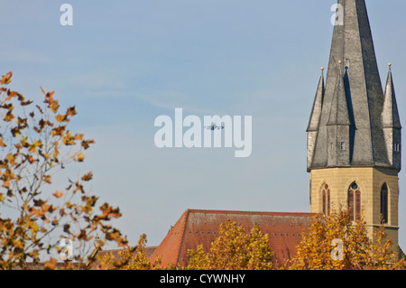 German Air Force Panavia MRCA Tornado fighter bomber jet passing a Christian church in low level flight, South Germany - Stock Photo