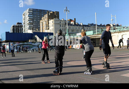 Brighton Sussex UK 11 November 2012 - People out enjoying the Autumn sunshine as they learn to skate on Brighton - Stock Photo