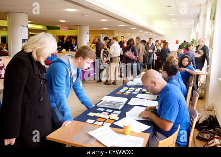 A student and parent attending Brighton University Open day for prospective students admission, Brighton UK - Stock Photo