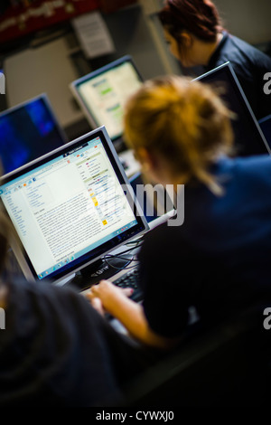 Teenage girls using computers  in an information technology class in a secondary comprehensive school in Wales UK - Stock Photo